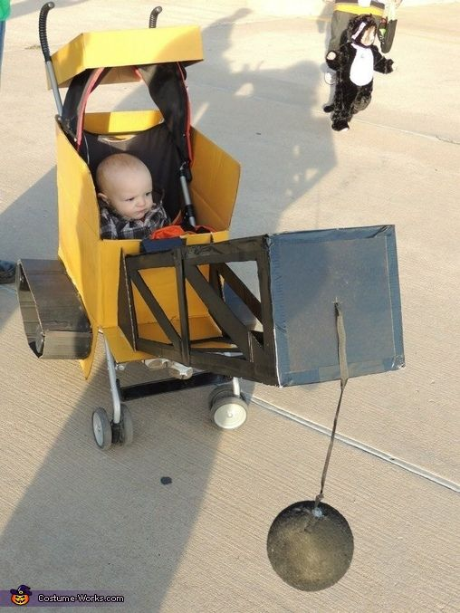 Kayla: Kanon Gilchrist Cost: $8 spray paint Basic use of an xacto knife and scissors and 8 different card board diaper boxes. Frame is on a stroller.