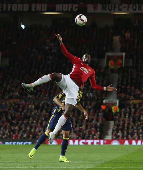 Paul Pogba of Manchester United in action with Josef during the UEFA Europa League match between Manchester United FC and Fenerbahce SK at Old...
