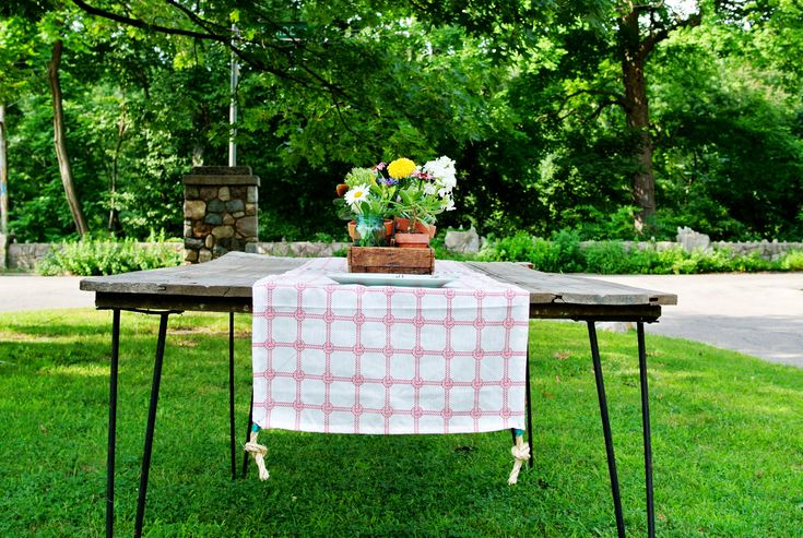 Create this cleaver table runner with a couple extra pillow cases and a few fun embellishments. We chose nautical pillow cases for summer and finished them