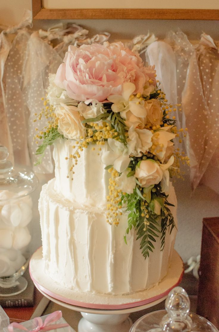 trailing cake topper of peony, orchids, roses and wattle and peppercorns