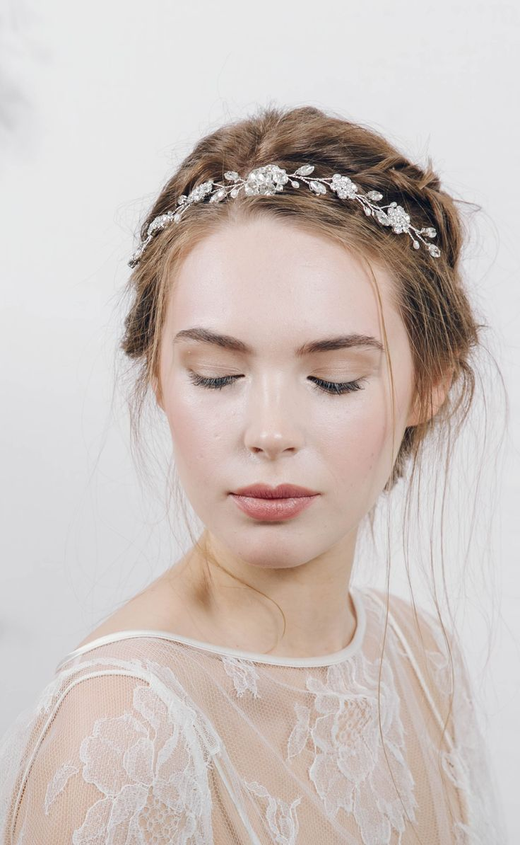 http://www.debbiecarlisle.com/collections/headpieces/products/crystal-and-pearl-bridal-browband-hair-vine-estelle