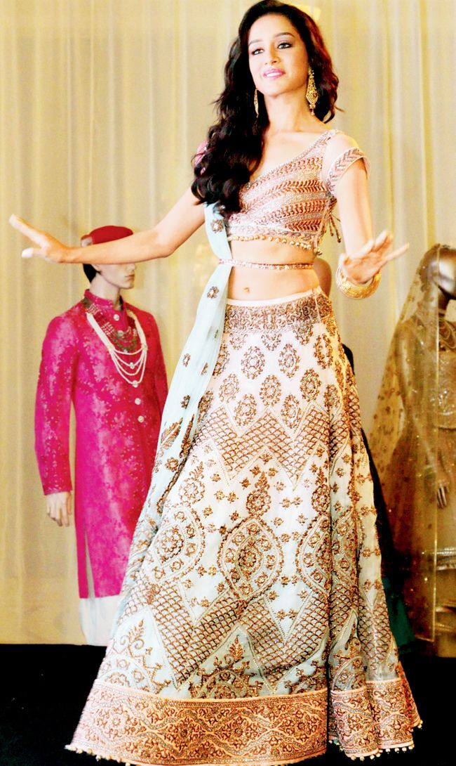 Shraddha Kapoor in an ivory and blue embroidered ghagra choli at the logo launch of BMW India Bridal Fashion Week 2014 in New Delhi.