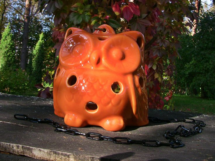 Ceramic orange owl. Bright color for your home, glazed balcony or garden. A small candle can be placed inside the owl.