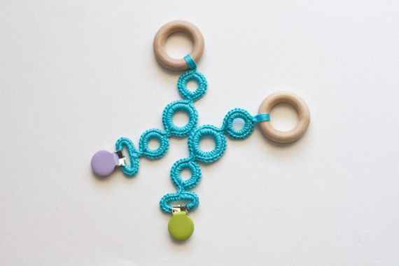 Clip on all natural wood teething ring. Love this idea, genius! #teething #teethingring #teether #woodteether #naturalteether #ecobaby #baby #crochet #moderncrochet