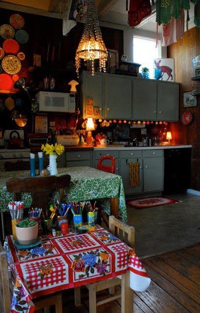 so boho, so warm, even has a child's table w/ art/school supplies..LOVE the undercabinet lighting & chandelier..love love love!