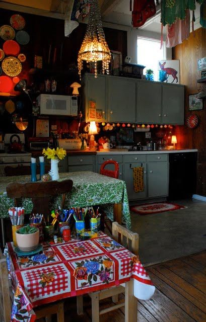 so boho, so warm, even has a child's table w/ art/school supplies..LOVE the undercabinet lighting & chandelier..love love love!