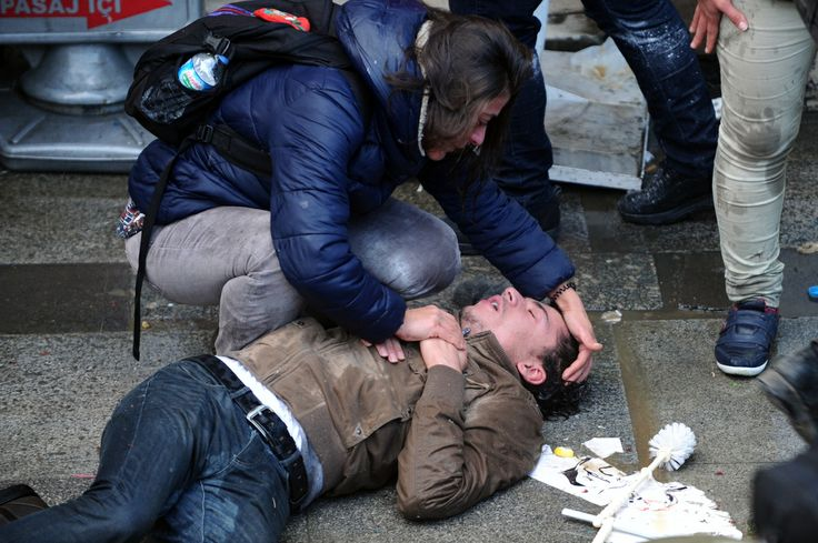 A protester is affected by tear gas during clashes with police after the funeral of Berkin Elvan on March 12, 2014 in istanbul. Riot police fired tear gas and water cannon at protesters in Ankara and Istanbul on Wednesday as tens of thousands took to the streets to mourn a teenage boy who died from injuries suffered in last year's anti-government protests.