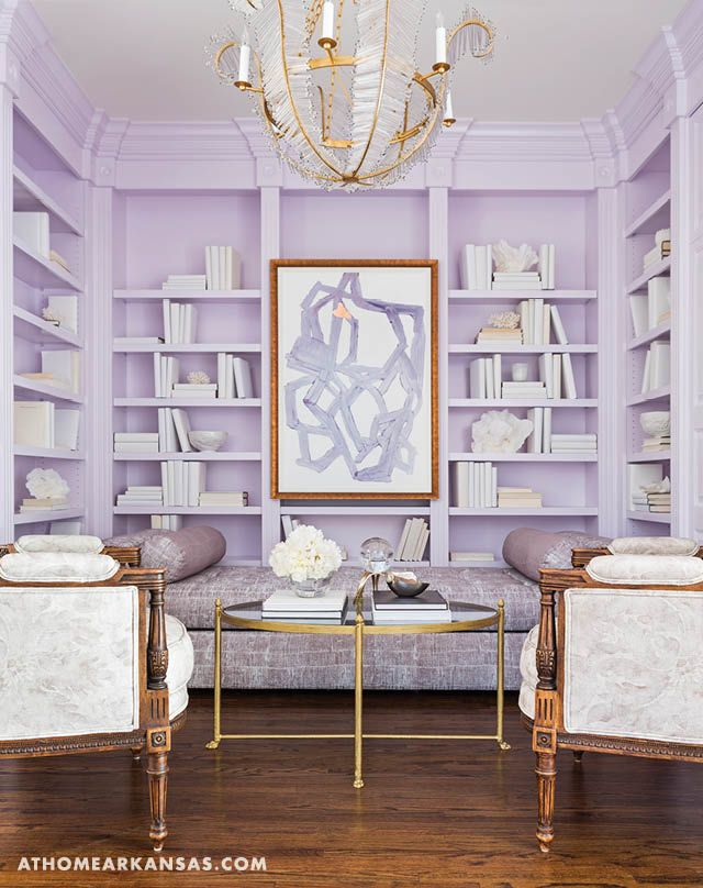A contemporary daybed folds out to a queen bed in the library, making room for extra guests and coordinating nicely with the modern shelving and an eye-catching chandelier.   A Stylish Expansion   At Home in Arkansas   August 2016   Purple   Library   Study   @cobblestonevine
