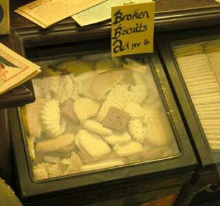 Broken  biscuits - we got ours from the indoor market. The big tin boxes with glass windows were just at eye level to a small child. A 1 lb. bag of mixed - kept us going all week. Mum & Dad occasionally had a small bag of  wafers but if we were having visitors we had a 1 lb. bag of chocolate broken biscuits. How times have changed :)