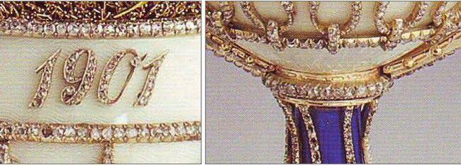 Sotto forma di un cesto di fiori di campo, ha il corpo d'argento ricoperto di smalto opalescente color madreperla, applicato con un lavoro a traliccio realizzato con diamanti taglio rosa. La data,1901, è anch'essa in diamanti taglio rosa; la base è in smalto blu scuro. La bella composizione di fiori di campo si trova appoggiata su del muschio verde in fili d'oro.