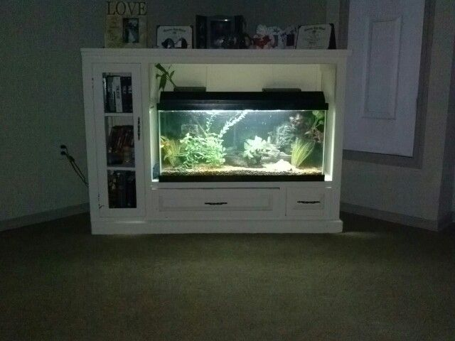 Old  entertainment center into a fish tank stand :)