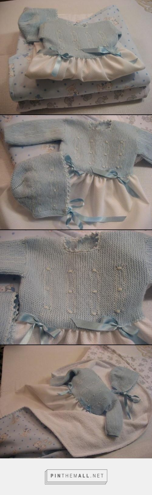 """Beautiful basic baby sweater in powder blue, fastened in back. Garter stitch worked sideways with white bullion stitch embroidered details; finished with crochet picots in powder blue perle cotton (See https://www.pinterest.com/pin/460563499368794620/). Here sewn to a gathered piqué fabric skirt to form a long gown (""""faldón""""). Bonnet matched to the jacket."""