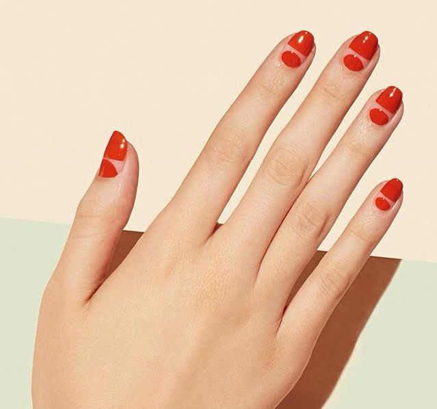 Negative space moon nails in red by paintbox nails London