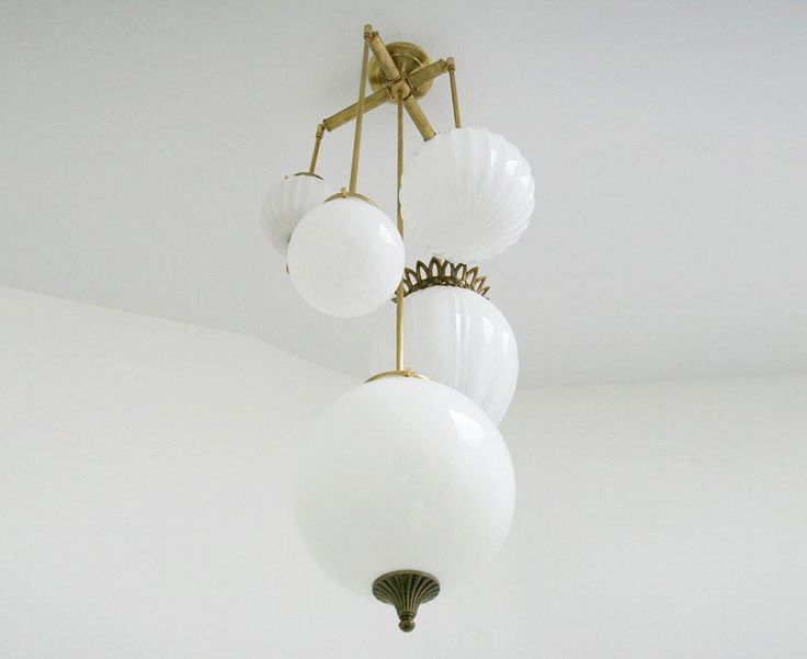 Michelle James lighting combines meticulously selected and assembled vintage parts to create sculptural fixtures imbued with an old world elegance.