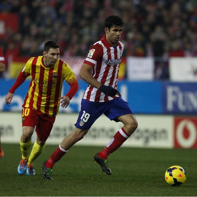 Atletico's Diego Costa, right, in action with Barcelona's Lionel Messi from Argentina, left,  during a Spanish La Liga soccer match ...