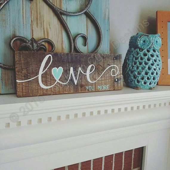 This love you more wood sign is beautifully stained in a walnut finish and hand painted.  The heart accent is a sweet, colorful touch. This wood sign is perfect for a rustic wedding sign or wedding decor. This sign is also a great gift for a soon to be bride or an anniversary gift. The wood sign is approximately 5x14 it comes with hardware attached and is ready to hang! It would look beautiful on a gallery wall. PHOTO 1: SEA FOAM GREEN PHOTO3: GOLD PHOTO 4: BAHAMA BLUE  Each item is freehand…