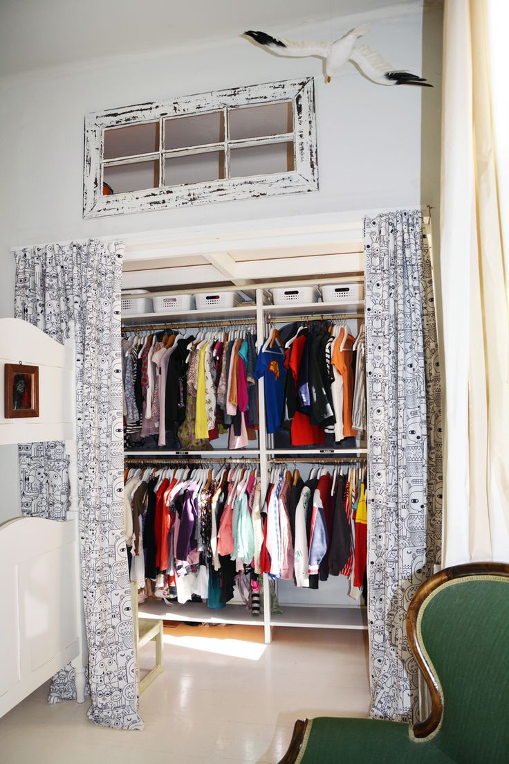 Clothes closet for three kids: made of the Finnish Lundia® shelves (recycled). Up above a loft for one of the three.