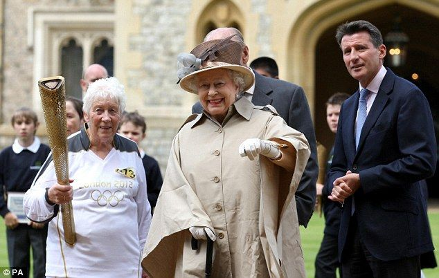 'Extraordinary': The same spirit of celebration was found when the Olympic flame reached the UK, said the Queen, pictured here with torchbearer Gina Macgregor (left) and London 2012 chairman Lord Sebastian Coe