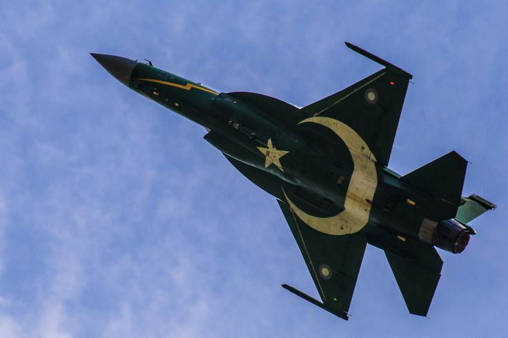 Pakistani Air Force JF-17 Thunder performing aerobatics over Islamabad on Defence Day, 6 September 2015, the 50th anniversary since the Indo-Pakistani War of 1965 officially broke out. JF-17 Thunder with Pakistani flag livery.