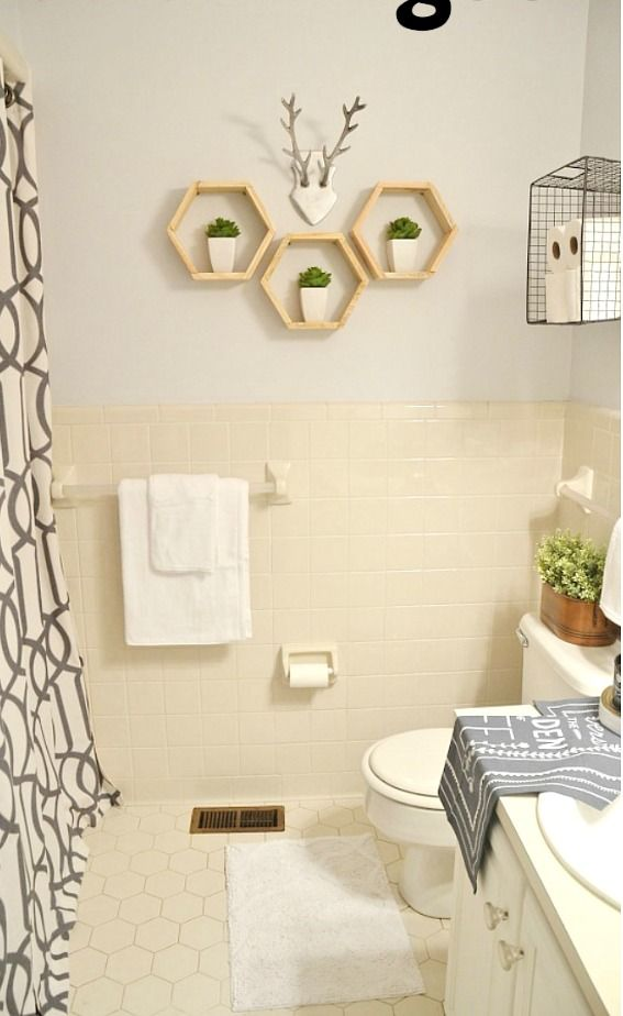 In this rental bathroom decoration project, Liz Marie completely transforms a dark and dingy rental apartment bathroom to a relaxing and modern space with an airy coat of Gray Shimmer. She adds floating hexagon shelves to bare walls and cozy touches like a fresh potted plant and printed bathroom towels. @lizmariegalvan