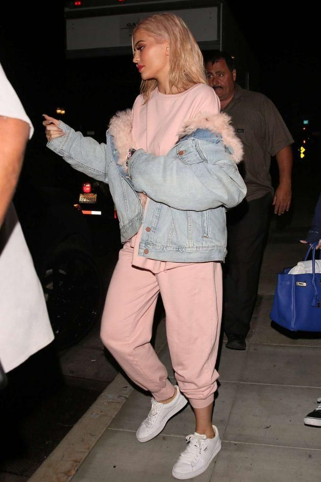 Kylie Jenner wearing Puma Basket Classic Sneakers, Skodia Stanley Sweatpants, Skodia Rocky Sweatshirt and Alexander Wang Boyfriend Denim Jacket with Fur