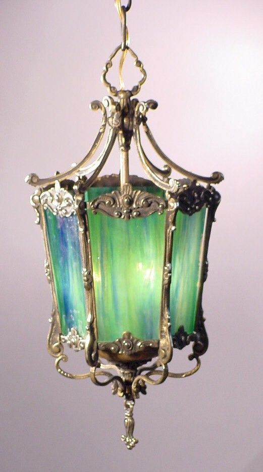 Berengia, Blue Green Glass Lantern. So much lovliness... Link seems to be pointlessness. Love the glass though.