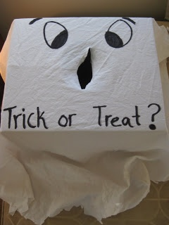 Fill box with treats and a few tricks (like plastic bugs or rocks). Mix goodies with polyfil stuffing. Staple fabric to cardboard box. Cut a slit for little hands to fit through. Will kids find a trick or a treat?
