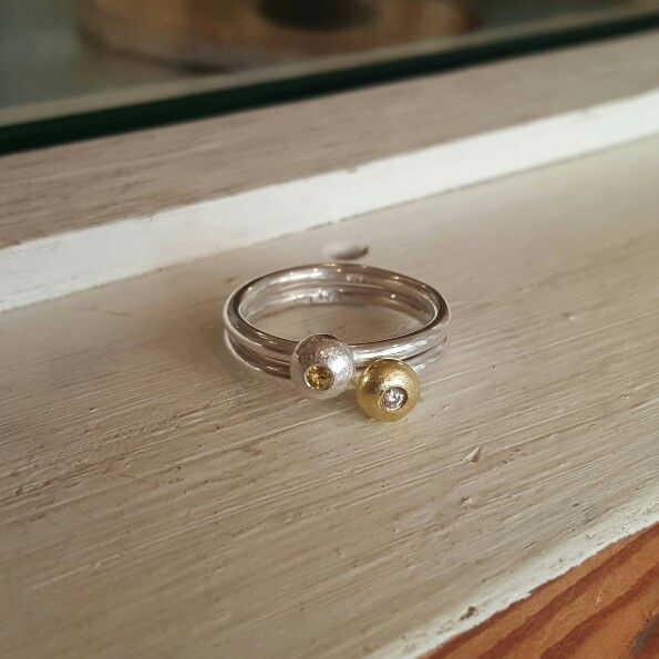 "Stacking ""pearl"" rings in sterling silver and yellow gold with white diamond and yellow sapphire. By Sunggee Min"