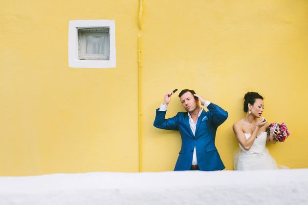 Caught on Camera fixing hair and make up before a great shot -  Post Ceremony Photo Session - Wedding by Stella And Moscha - Photography by Thanos Asfis & Yiannis Alefantou  Oia - Santorini - Greece