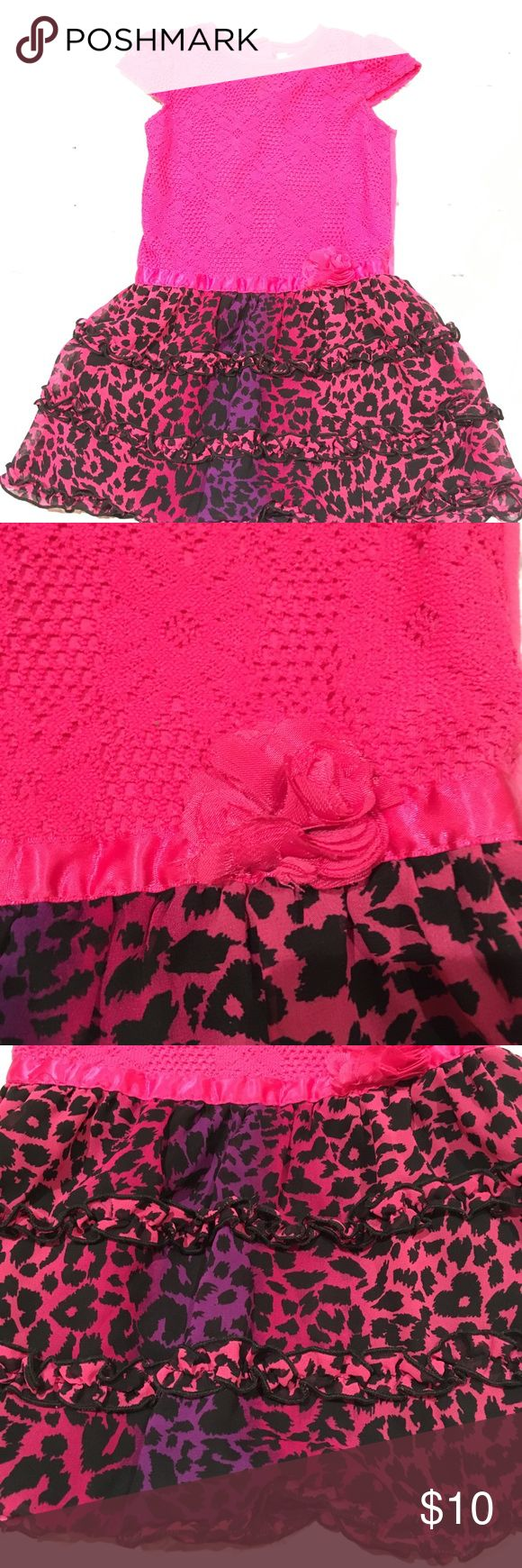 Youngland size 4T pink cheetah print dress - Euc Youngland size 4T pink cheetah print dress - Euc.  This is a cotton and polyester blend dress. Adorable lease like on the top and a fun cheetah print on the bottom. Drop waist with a small flower. The dress  has been worn but it is in excellent used condition. No rips or stains. The flower is a little bit tethered more than likely from my toddler pulling on it but still looks great. Youngland Dresses Casual