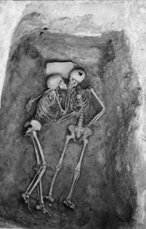 """The University Museum exhibits the """"Hasanlu Lovers,"""" a pair of entwined skeletons who died together in about 8oo B.C."""