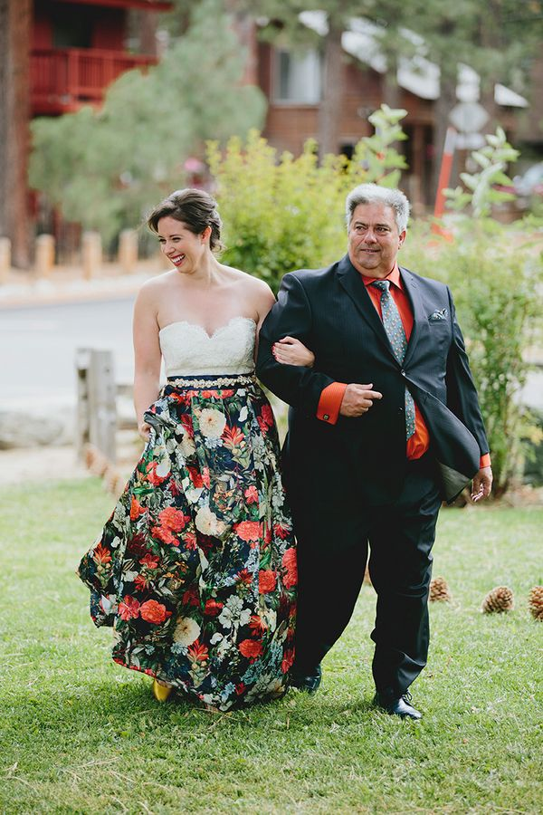 love the floral skirt on her dress, the pitty escort, the rainy Tahoe setting...wow