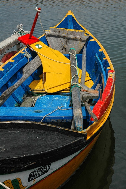 Boat by CGoulao, via Flickr This reminds me of the fishing boats in Chile. The colors are striking.