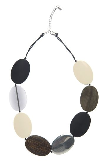 The Short Resin, Metal and Wood Necklace features wooden, resin and metal beads strung onto waxed cotton cord in a random…