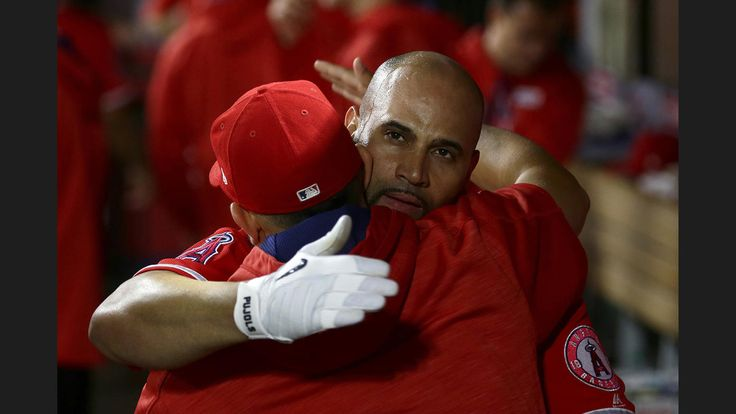 Angels slugger Albert Pujols joins the 600-homer club with a grand slam  -  June 3, 2017:     Albert Pujols is hugged by a teammate in the dugout after hitting career homer 600 against Twins pitcher Ervin Santana at Angel Stadium, Saturday.