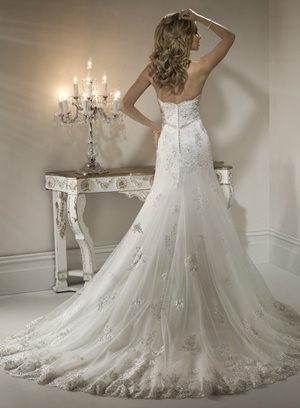 "Maggie Sottero ""Natasha"" Obviously, I think that a wedding dress must include a (scalloped) lace trim!"
