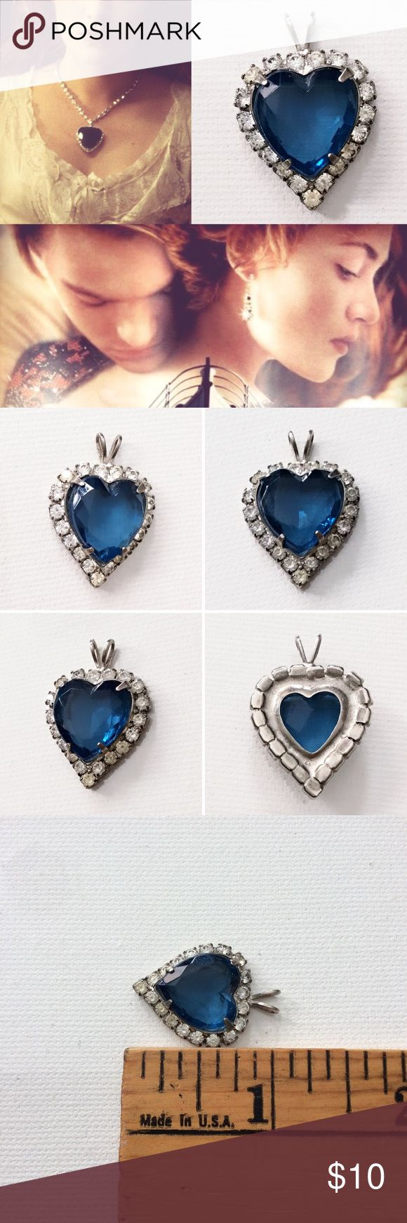 90's TITANIC inspired Heart of the Ocean pendant Fun 90s NOSTALGIA if you remember when the movie Titanic came out!  I got this as a teenager in the late 1990's.  Rhinestones set in metal with plastic heart.  Minor scratches on the heart, but they're so tiny it was hard to get them in a photo. Look at the last photo to see what I mean.  Put it on a rhinestone necklace and it will look like a mini version of the necklace in the movie!  Also cute on a simple black choker or silver chain…