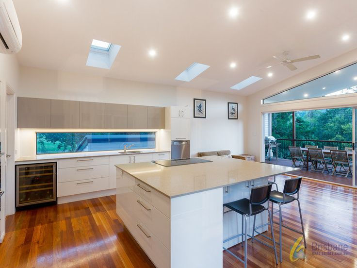 Modern Kitchen - fixed panel window, skylights, stone benchtop + state of the art Miele appliances | Tru-Built Builders Queensland