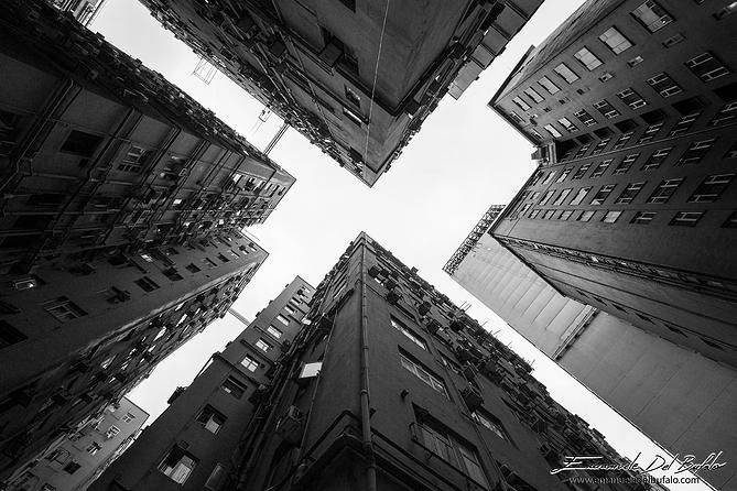 """Hong Kong - """"X"""" - by Emanuele Del Bufalo Hong Kong is covered with skyscrapers and huge residential complexes full of small apartments, the price of real estate here is very high. If you leave the main roads, you can get lost in a maze of narrow streets and passageways between the tall buildings. emanueledelbufalo.com the long-term traveler"""