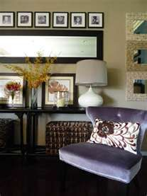 Full length mirror hung horizontally with picture frames across the top--good idea for over our couch.