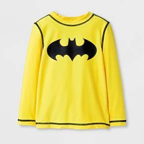 Help your little Caped Crusader suit up for swim time with this Batman Rash Guard. This awesome swim shirt keeps his torso protected from the sun's harmful rays, so he can just focus on having a great time in the water. He'll love the cool Batman logo and vibrant color, and you'll love that he can stay dry and burn-free for his entire swim mission.