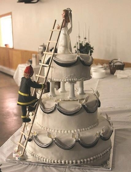 Such a cute wedding cake, love the idea of being rescued by a fit fireman!  Kerrie G Weddings