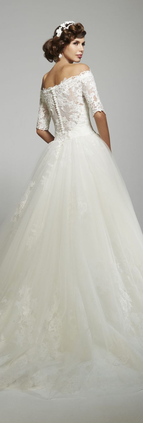 Sophisticated lace off-the-shoulder ballgown wedding dress; Featured Dress: Matthew Christopher