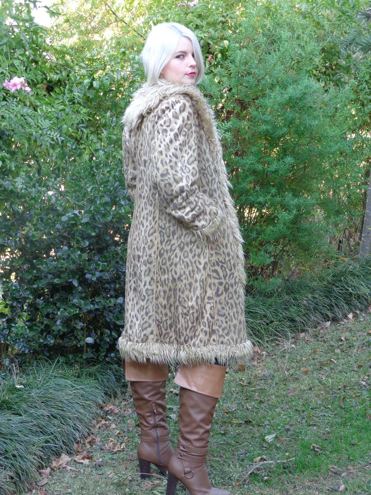 Faux fur leopard print coat, tights and brown leather boots from the blog www.mainstreetfashion.co.za
