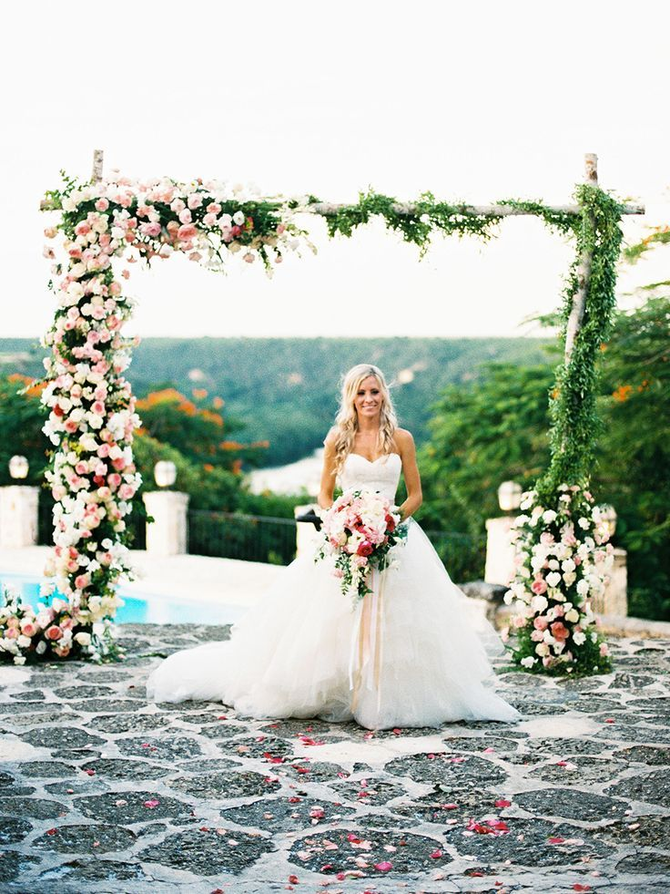 Is there any better way to kick off #WeddingWednesday than with a tropical destination wedding in Dominican Republic? This beautiful celebration from Asia Pimentel Photography, Irosca Gonzalez Wedding & Events Planner, and TRES EVENTOS is chock full of blooming flowers, a poolside ceremony,   #Asia Pimentel Photography #beach weddings #Dominican Republic #flowers #tropical