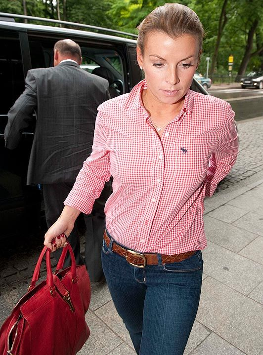 Coleen Rooney arrives at her hotel in Krakow, Poland before meeting up with husband Wayne for lunch.