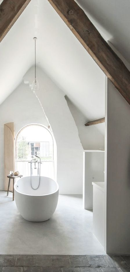 = white bathroom, chimney flue and beams = The Little Monastery B&B