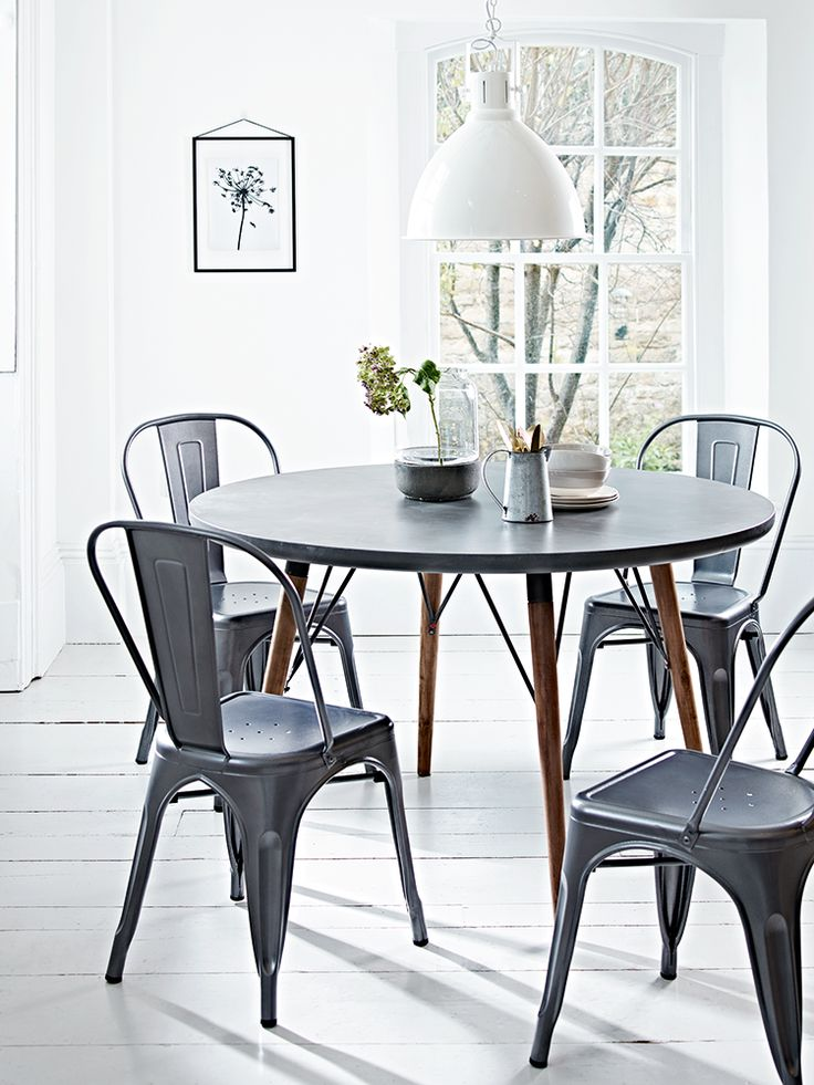 Round table with soft industrial styling.