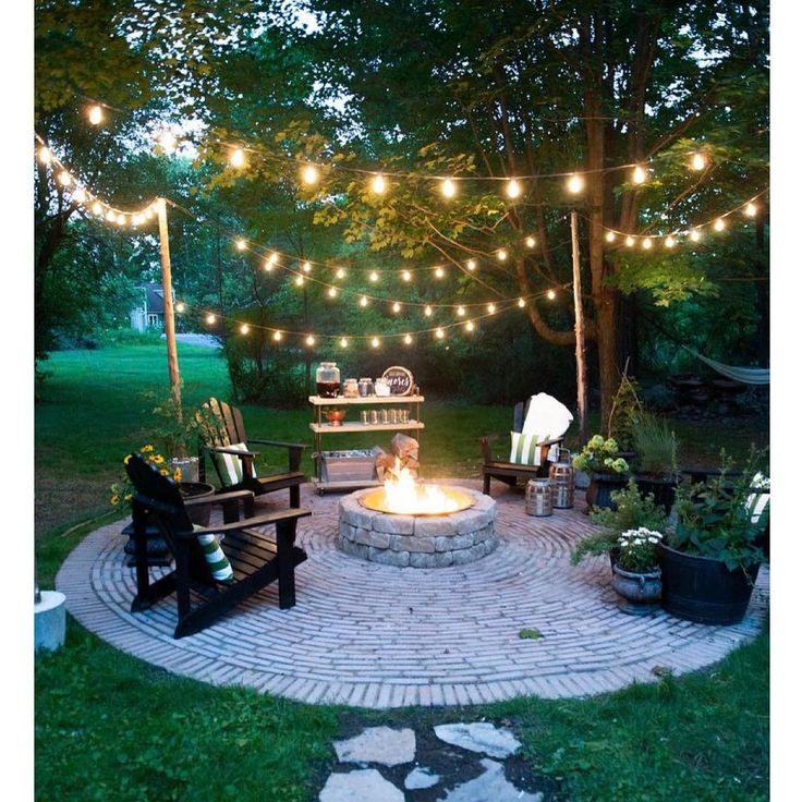 The 25 best backyard string lights ideas on pinterest for How to hang string lights without trees