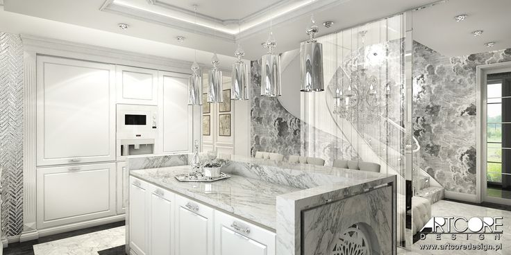 Piękna kuchnia w stonowanej, klasycznej stylistyce. Jasne szarości oraz odcienie bieli w połączeniu z ciemnymi elementami podłogi nadają eleganckiego i eksluzywnego wyglądu zaprojektowanemu wnętrzu. Więcej na www.artcoredesign.pl .